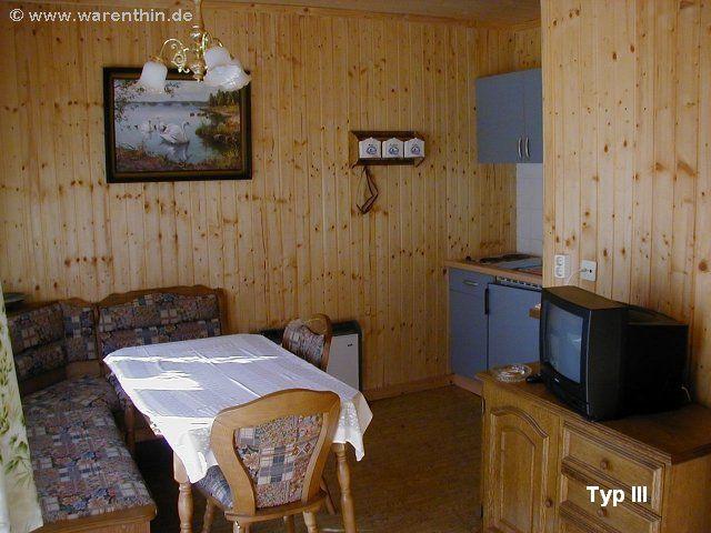 Wohnzimmer eines Bungalows vom Typ III